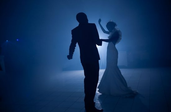 African Wedding couple dancing in blue light