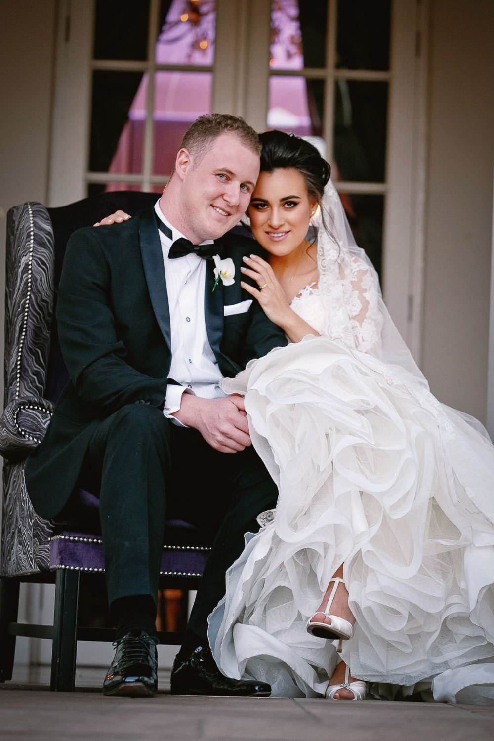 Bride and groom sitting down at the Fourseasons Hotel The Westcliff Hotel Johannesburg