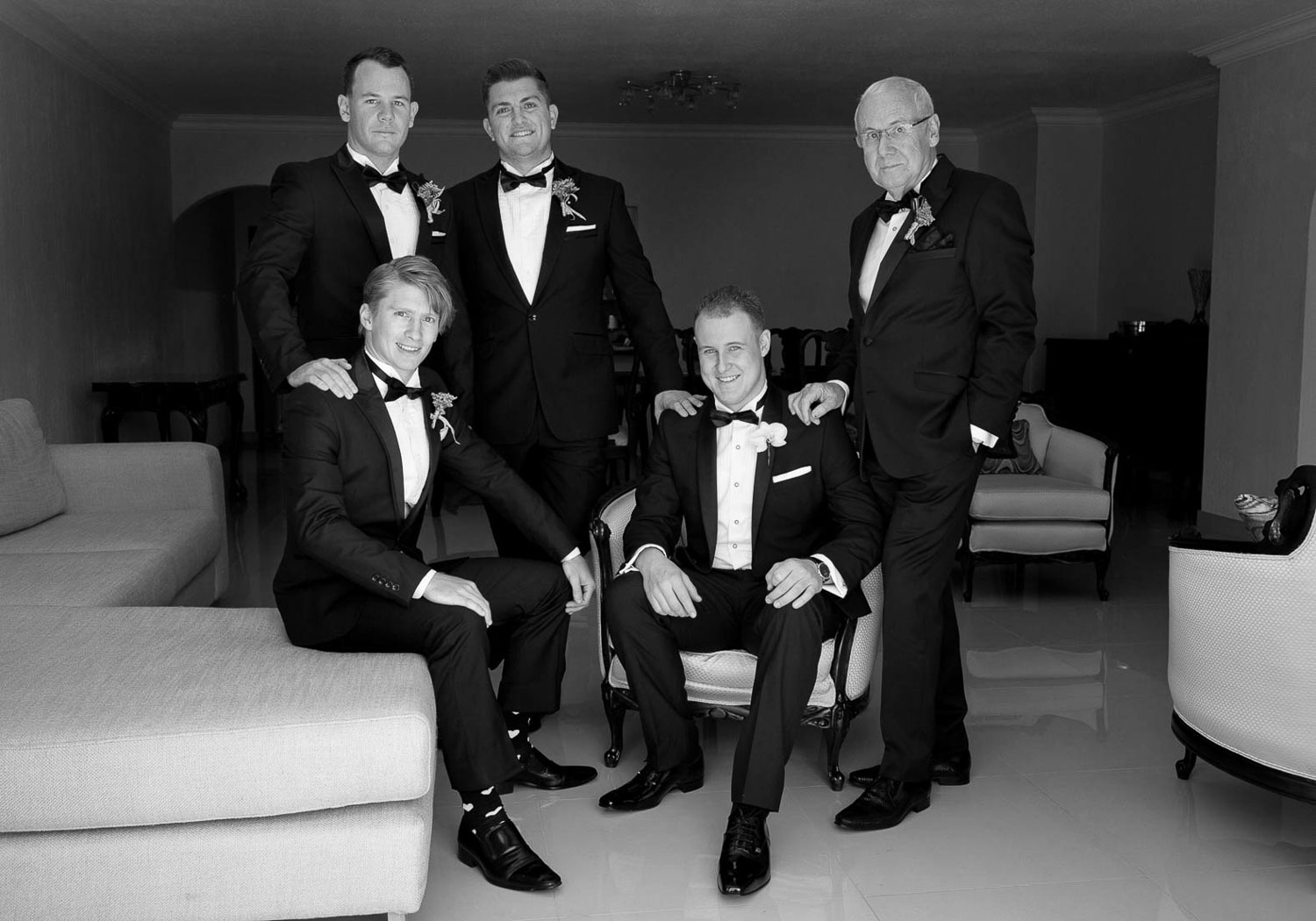 black and white image of the groom and his men at Four Seasons Hotel The Westcliff