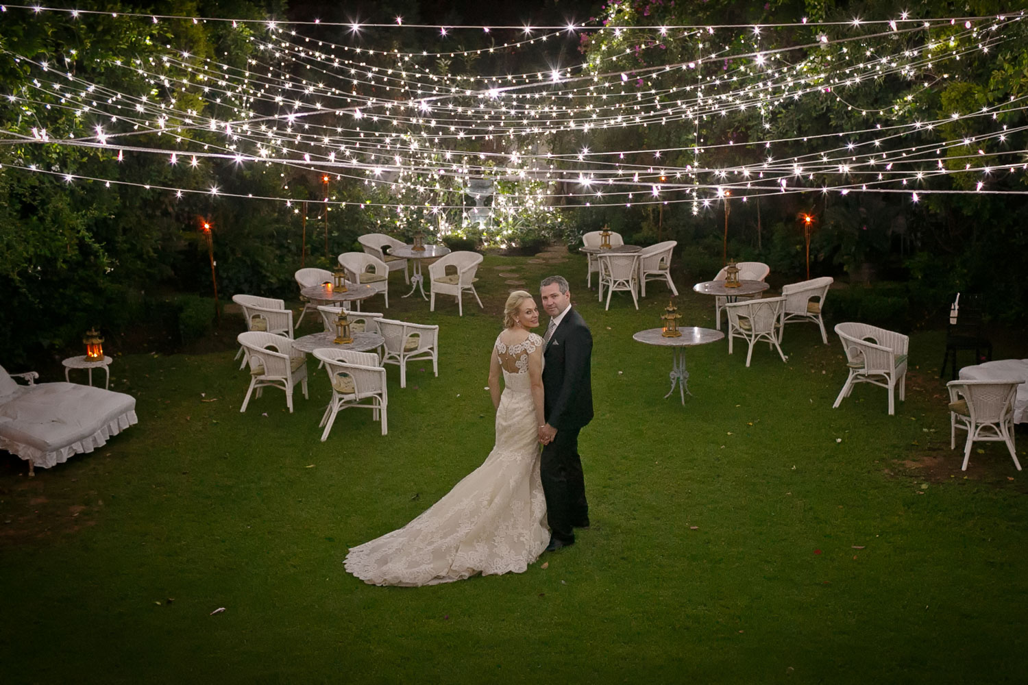 bridal couple under ferry lights at Illyria House in Pretoria