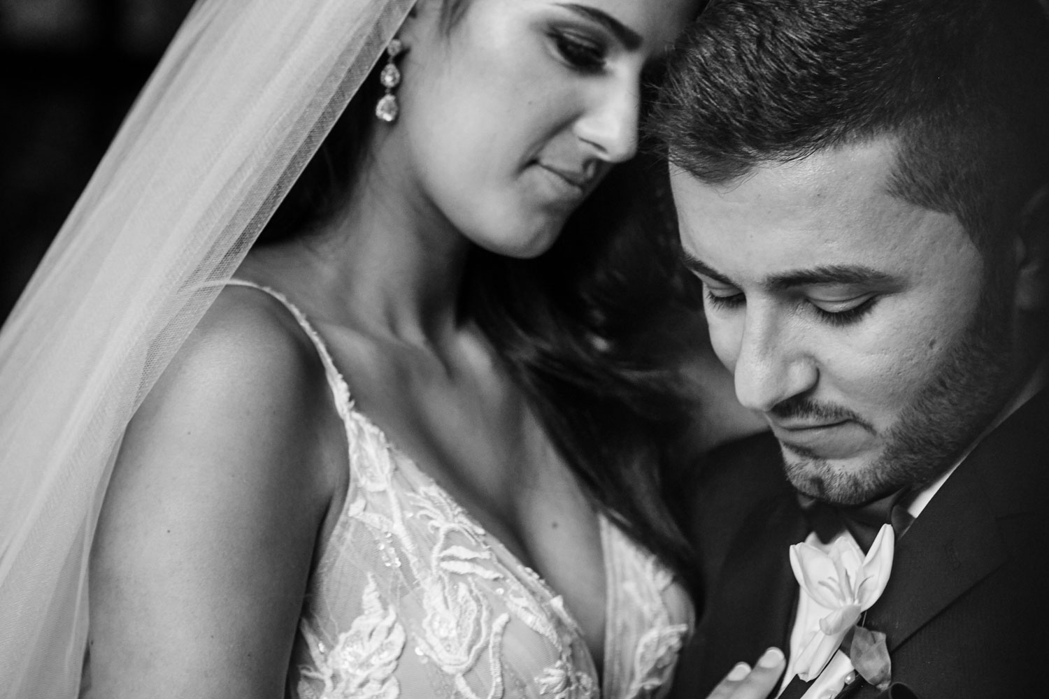 a black and white wedding image of the couple embracing at Le Chatelat Residence