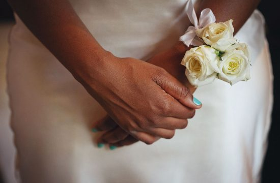 bridal hands and flowers at the red ivory lodge