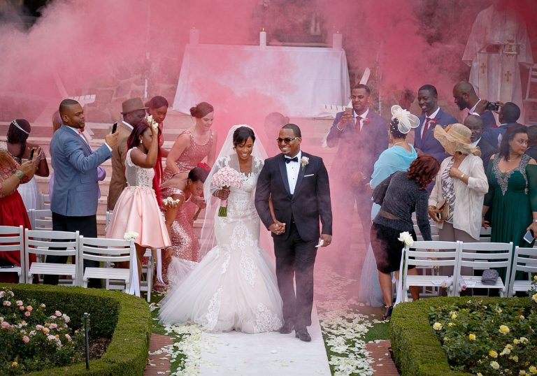 African couple walking down the aisle at Summerplace Wedding Venue