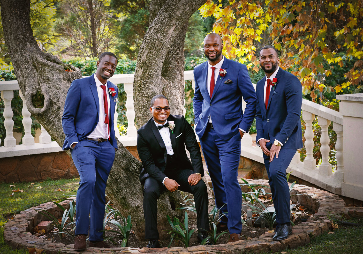 groom and his best men posing under the tree at Summer Place Wedding Venue