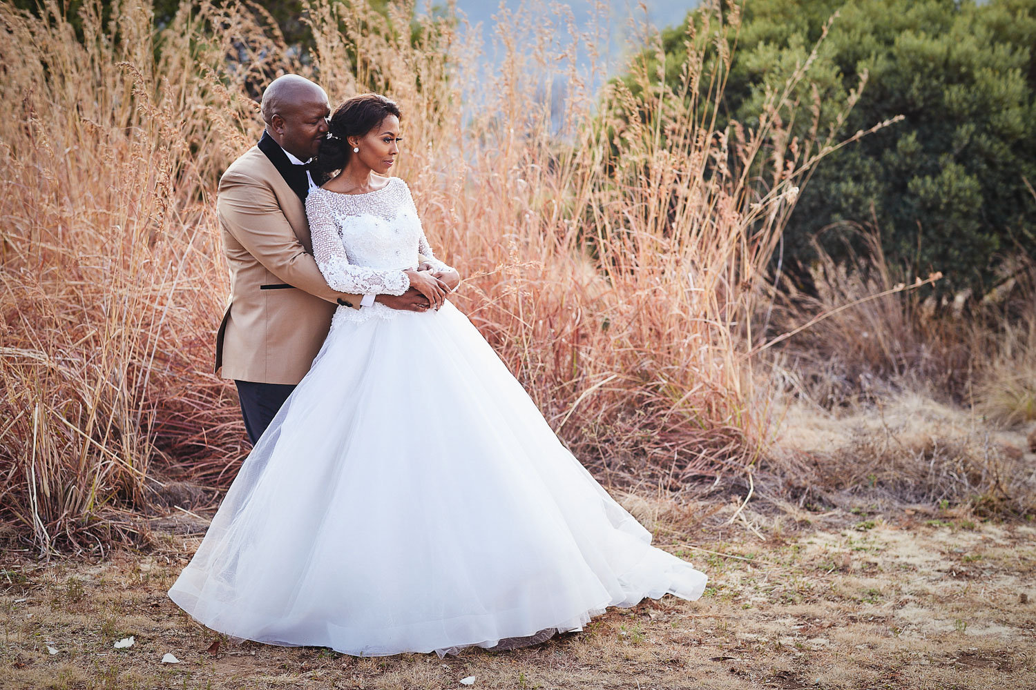 African wedding couple posing at Thaba Eco Hotel wedding venue
