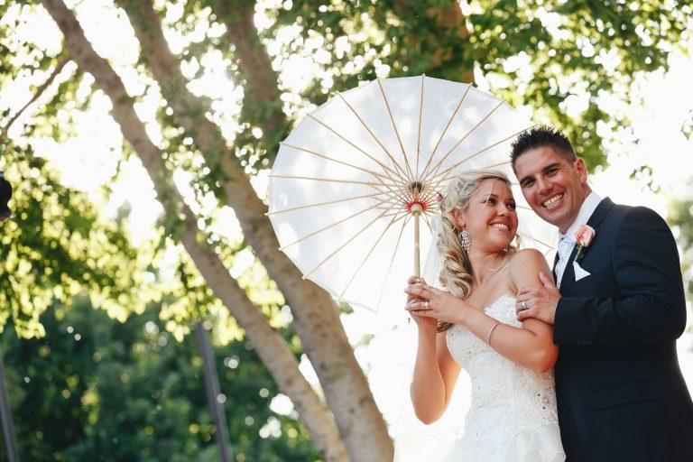 wedding couple posing under Chinese umbrella at Palazzo Hotel Montecasino