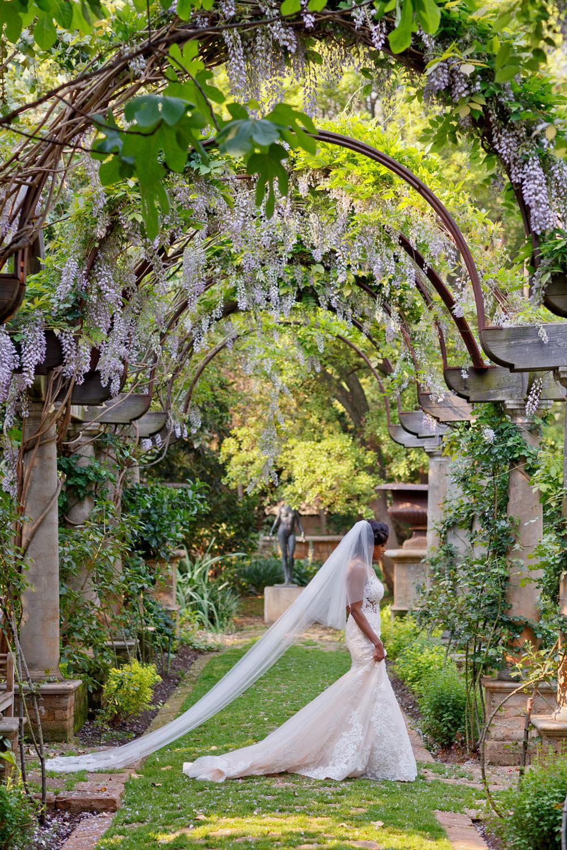 bride walking through the gardens at Beechwood Gardens in Hyde Park Sandton