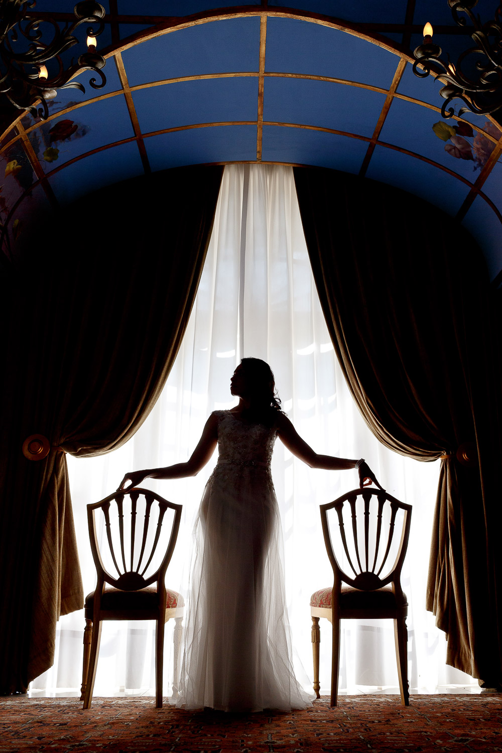 bride standing in front of the window at the Munro Boutique Hotel in Johannesburg