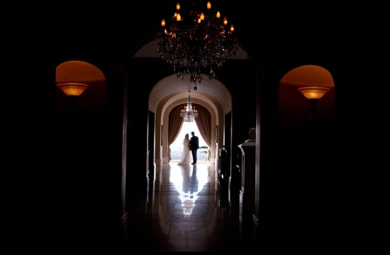 Bride and groom standing at the keyhole at the Munro Boutique Hotel wedding venue in Parktown Johannesburg