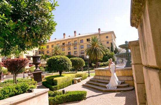 Johannesburg bride posing in front of the fountains at The Palazzo Hotel Montecasino in Johannesburg