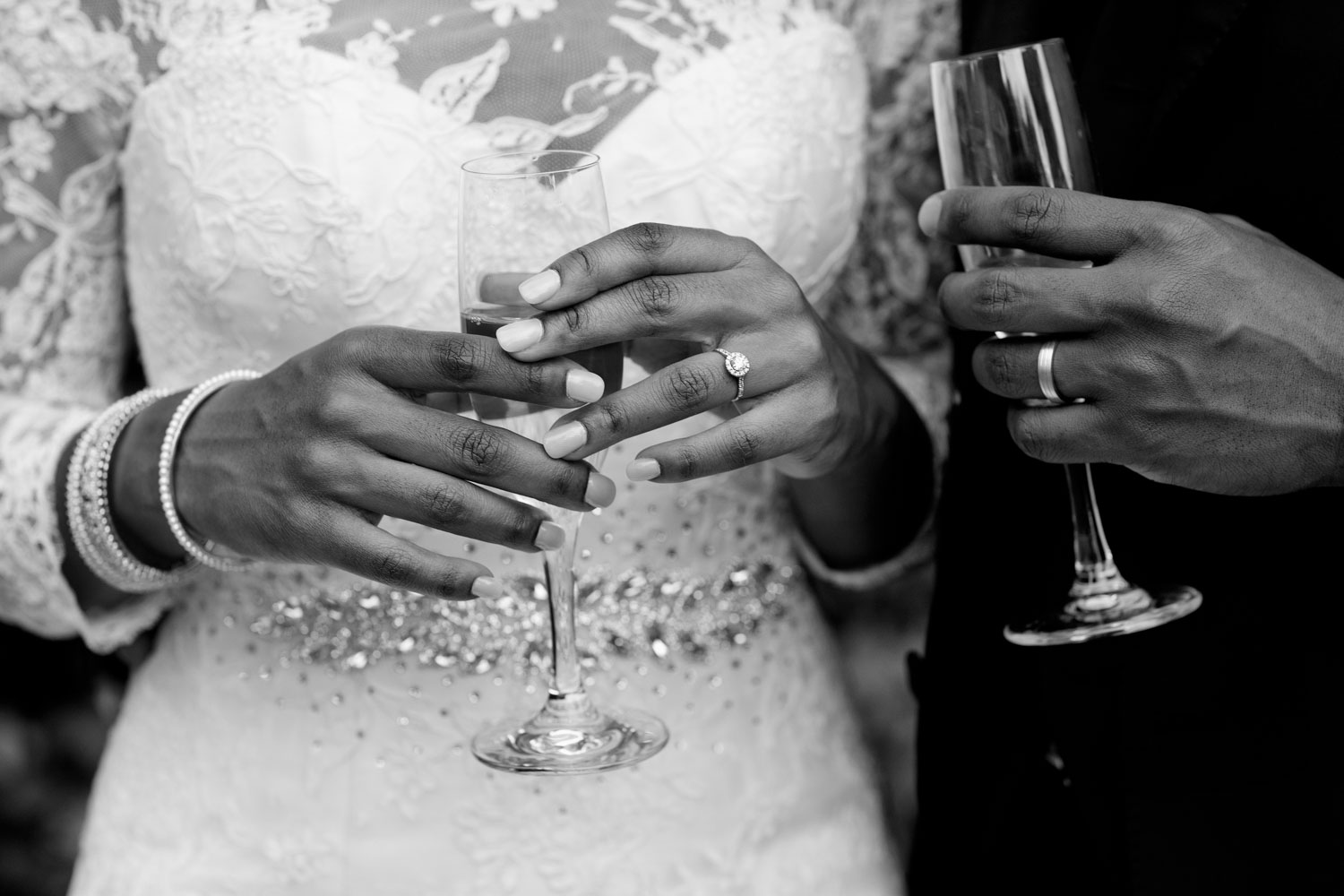 wedding couple holding champagne Glasses