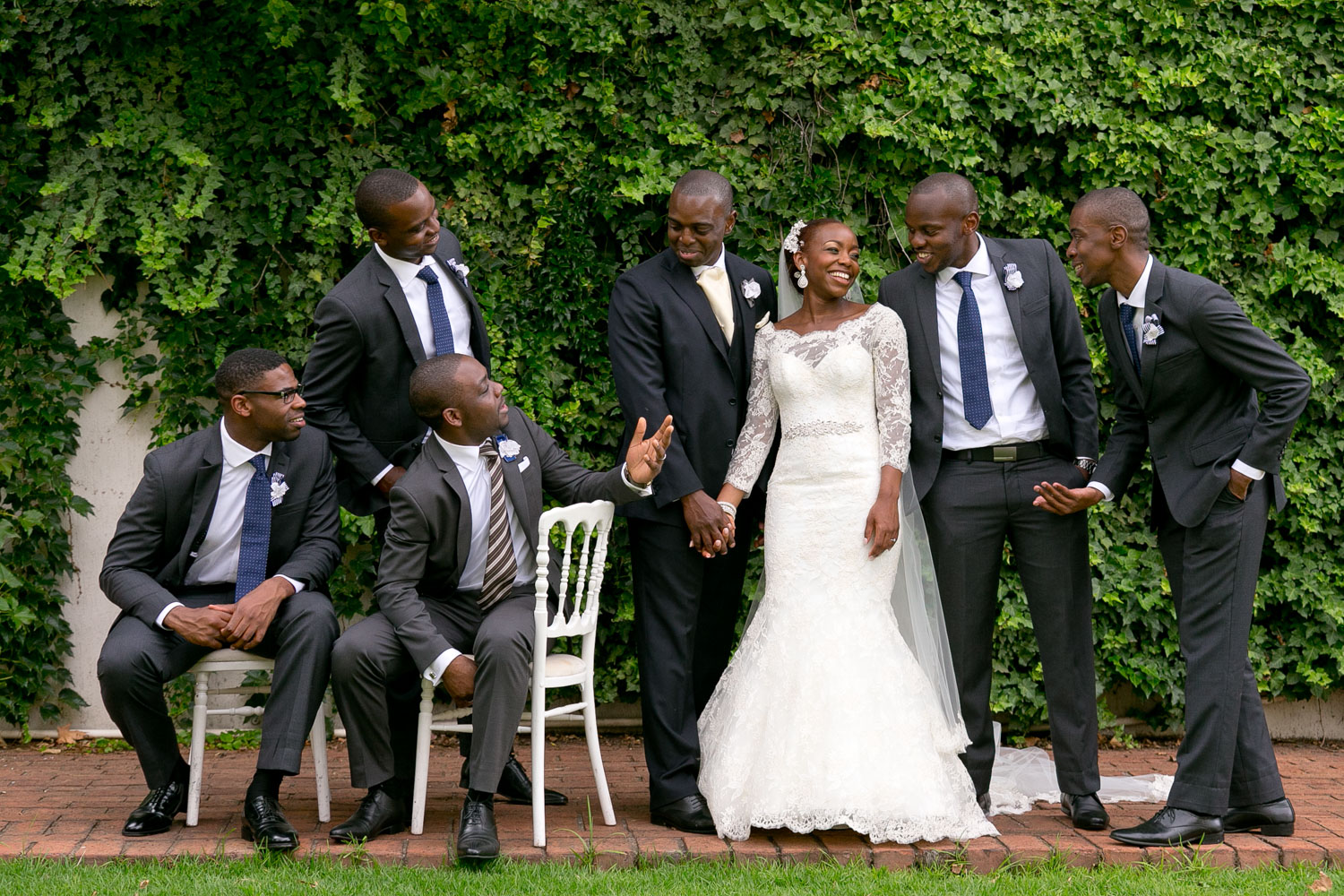 groomsmen laughing with the married couple at a Johannesburg Wedding Venue